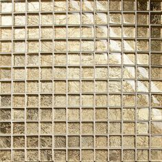 Golden Midas Mosaic Tile. A metallic gold glass square mosaic tile on a mesh-netting, using this tile along side many of the Arabesque tiles highlights the liquid gold adornment, adding a sense of luxury to any interior styling.