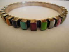 925 sterling silver Mexican bangle bracelet, turquoise, topaz, gemstone settings. $60