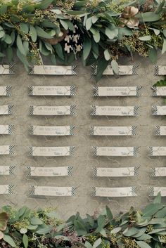 an escort card display made from chicken wire and foliage  Photography By / onelove-photo.com, Design, Planning   Florals By / charlieolivia.com
