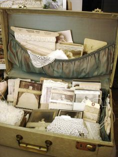 I love how Dawn at the Feathered Nest store her lace on old photos. On my work table ~ I love how Dawn at the Feathered Nest store her lace on old photos. On my work table ~ Antique Booth Displays, Antique Booth Ideas, Vintage Display, Vintage Decor, Vintage Lace, Suitcase Display, Suitcase Decor, Vintage Suitcases, Vintage Luggage