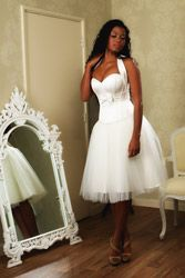 Ivory satin corset with concealed zip.