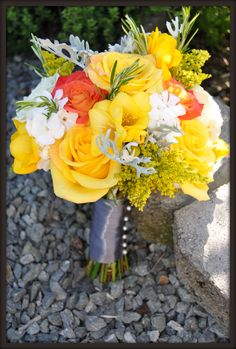 Citrus Colored Wedding on Samish Island--golden rod, yellow roses, dusty miller, yellow hypericum, coral roses, white stock, rosemary