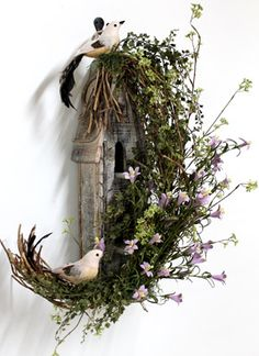 Use crescent shaped vine/moon, decorate with black/orange feathers, flowers, etc. for Halloween.