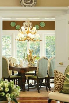 Love this color combination minus the brown soffet. Trying to blend the cream, pale gold, green and pale turquoise in our dining room.
