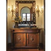 This Powder Room, With Its Warmly Hued Walls, Terra Cotta Tile Flooring,  And Ornately Carved Antique Vanity, Looks To Spanish Colonial Style  Architecture ...
