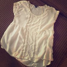 Xs AEO FLOWY ivory blouse Perfect with jeans or dressing upsoft and flowy material. One small flaw( pictured ). Not noticeable. American Eagle Outfitters Tops Blouses