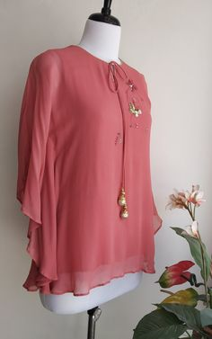 Intricate resham thread and sequin hand work Round neck with front keyhole and tie-up Kaftan like pattern Chic Outfits, Trendy Outfits, Fashion Outfits, Office Outfits, Fashion Tips, Diy Clothes And Shoes, Sewing Clothes, Cotton Tops For Jeans, Stylish Tops For Girls