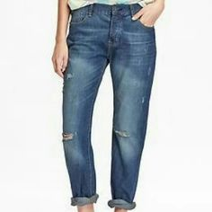 Relaxed Boyfriend Distressed Button-Fly Jeans The relaxed boyfriend fit sits below the waist, relaxed through hip an thigh. Straight leg. Button-fly front with scoop front pockets. Soft, medium denim in Jackson wash. Wear them cuffed or straight. Tears and patches give worn look. Old Navy Jeans Boyfriend