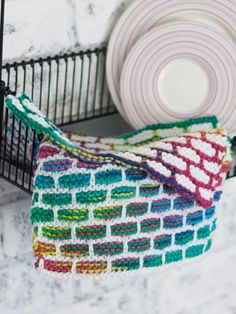Free pattern - A bold, colorful brick stitch pattern makes this dishcloth a fun and easy way to add a touch of contemporary cool to your kitchen. #knit #rainbow