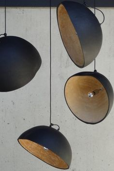 GOURD PENDANT LIGHT made from dried gourds. matt black finish on the outside/ small fitting/ m. wire with black plug/ max. irregularities and varying sizes (from arround 35 cm to 50 cm) are what separates them from industrial light fittings.