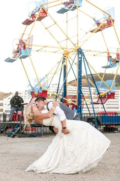 Unique carnival-themed wedding provided a perfect wedding day photo of the bride and groom! {Leah Marie Photography}