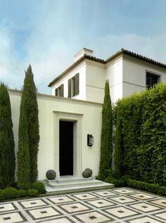 "A fresh contemporary twist on Italian/Tuscan architecture. The tall Cypress trees are the perfect ""villa"" touch for this Californian home 