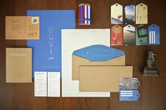 """branding of """"wanderlust"""" — luggage tags business cards and airplane route envelope liners. love."""