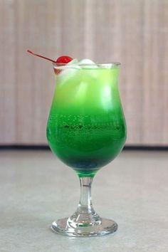 Zolezzi: Melon Liqueur, Blue Curacao, Vanilla Vodka, White Rum, Pineapple Juice, Soda Lemon-Lime, Orange Twist, Maraschino Cherry.