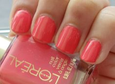 Tangerine Crush by L'oreal. I just painted my nails this color today & I love it! It is a bright, deep coral; a MUST for pale, sapphire-eyed blonds! Wedding Nail Colors, Wedding Nails, Bun With Curls, Bun Curls, Coral Pink Nails, Pink Nail Polish, Nail Polishes, Manicures, Nail Time