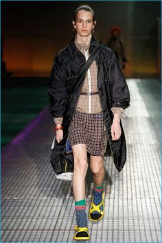 Sampling classic motifs, Prada injects its collection with a splash of checks.