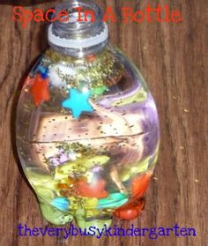 Space in a Bottle is one of those activities that I have modified throughout the years.  At first I poured light syrup in the bottles mixed with water to give it some texture.  But over the years I found the kids love it just the same with plain water.  Sometimes I have the my little ones draw on the water bottles with sharpies if time allows.    They add 8 pom poms for planets, star beads for stars, glitter for astroids and sequences for comets.    AND  Blue Food Coloring