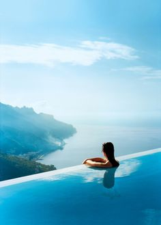Hotel Caruso Belvedere in Ravello, Italy located 300 meters high overlooking the Amalfi Coast, has an infinity pool with a view between the sea and sky.  Is that me?  I think that's me--in my dreams #monogramsvacation