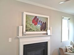 DIY frame for TV. Ideal for TV's over fireplace mantels and great for hiding messy wires.