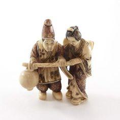 Mammoth Ivory Netsuke -  A Couple Carrying Lantern