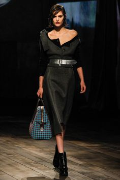 Prada- love the disheveled look, the flanel dress, military style platform combo punctured by a touch of gingham print in a classic bag