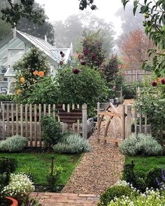 Dreamy garden with fence, gravel path and greenhouse garden cottage Jenny Rose, The Secret Garden, Secret Gardens, Garden Cottage, Farmhouse Garden, Farmhouse Homes, House With Garden, Garden Homes, Prairie Garden