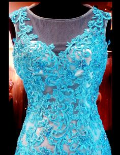 Lacy patterns adorn this sensational mermaid gown. The high illusion neckline together with its contrasting low open back, make this style unbelievably glamorous! ONLY at Rsvp Prom and Pageant, Atlanta, Georgia or BUY it NOW at http://rsvppromandpageant.net/collections/long-gowns/products/aqua-lace-mermaid-high-illusion-neckline-low-open-back-115mm01478900538