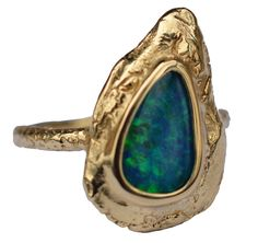 Ocean Flame ring in 18k recycled yellow gold with opal, price on request; Susan Wheeler Design