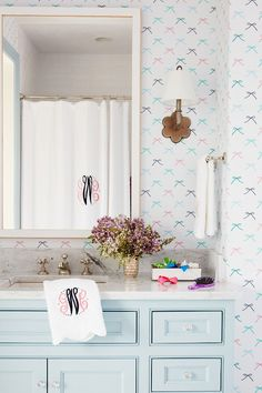 light turquoise bathroom s bathroom with aqua blue vanity and bow wallpaper 13466