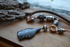 New to AthenasArmoury on Etsy: Tortuga Turtle Beach Bum Necklace - Bone Beads Metal Beads Leather Cording (24.00 USD)
