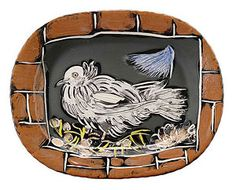 Colombe (Dove), 1949Artist: Picasso, PabloMedium: White earthenware clay rectangular dish with decoration in engobes (red,  yellow, blue, black), knife engraved under partial brushed glaze.