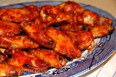 Ain't No Thing Chicken Wings - A combination of chili sauce and hot sauce with cider vinegar, garlic, ginger & Cajun seasoning, makes for a nice spicy kick in these chicken wings.