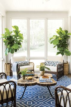 """""""This is an odd little porch on the side of my house. I liked the masculine feel of these wicker chairs, a staple on Southern porches."""""""