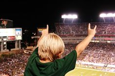 A young #USF fan throwing up the Bull Horns!