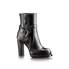 Discover Louis Vuitton Forefront Ankle Boot:  This edgy ankle boot in plain calf leather features distinctive padded details on the upper and a contrasting extended sole.