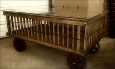 Coffee table made from a chicken crate...like those industrial wheels.