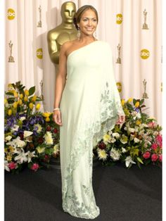Remember the days of Bennifer? Aside from having Ben Affleck on her arm, Jennifer Lopez wore this one-shoulder, asymmetric mint green Valentino number to the 2003 Oscars.  The gorgeous gown, which caught a lot of attention, was said to be inspired by a design that Valentino had created for Jackie Onassis in 1967.