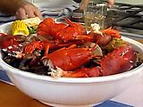 Kitchen Clambake Recipe.  Great idea to get my friends from Boston who also live in S Florida together for a little piece of home. One pot meal, Newspaper for table cloth and lots of ice cold Sam Adams. If your Boston accent is not authentic, you're not invited! Boston Cream Pie for dessert and of course Dunkin Donuts coffee.