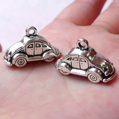 Lovely 3D car toy charms in Tibetan silver tone! Good for jewelry making like earrings, bracelet, necklace as well as zipper pull, bookmark, key chain, handbag charm, wine charm making, gift decoration and much more! Quantity: 2 pcs  Color: Tibetan Silver  Size: approx. 2.4cm (W) x 1.5cm (L) / 0.93 (W) x 0.59 (L)  Material: Metal, Alloy    For more transportation charms available, please check:  https://www.etsy.com/shop/MiniatureSweet/search?search_query=transportation+chm    For all the…