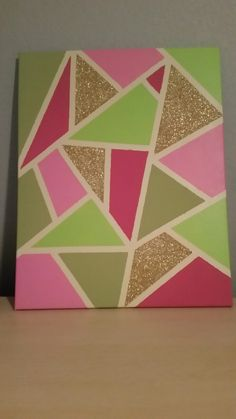 Canvas Art, made myself. Love this piece and colors. Just used masking tape, made random lines. The glitter was done with modge podge to insure it stayed on. Very easy and fun to do!
