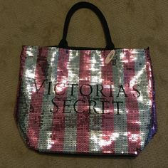NWT VICTORIA'S SECRET SEQUENCE TOTE perfect condition... never used. NWT. sequences front. plain back. zipper on top to close and open tote. perfect for the beach, overnight, etc!! super cute Victoria's Secret Bags Totes