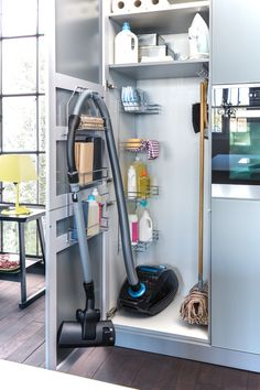 Organize your cleaning utensils in a secret storage cabinet