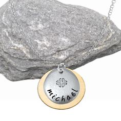 A very stylish everyday wear pendant for men and women.  A 20mm nickle free pewter pebble is hand stamped with your choice of name or word and character. Letters are 3mm Bridgette style. Behind the pebble is a 25mm golden bronze disc.  The pewter pebble itself has a natural organic feel and the contrast of metals adds wonderful visual appeal to this design.