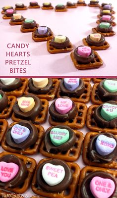 Candy Heart Pretzel Bites - we've taken an iconic Valentine's Day candy - Conversation Hearts - and turned them into a unique Valentine's Day themed pretzel snack. What a fun way to tell someone that you love them! For more great Valentine's Day Dessert ideas, follow us at http://www.pinterest.com/2SistersCraft/