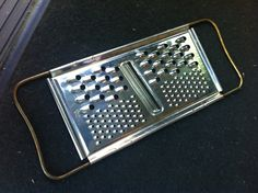 $.10 grater. Found at a church sale.