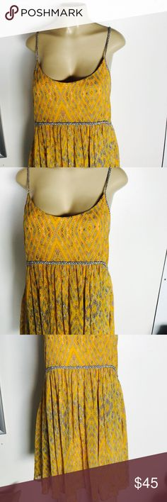 Free People women's dress Beautiful Yellow and Grey Floral Sumer/spring dress by Free People. Worn no more than 5 times, flowy and flattering. Size small would fit a size 2-8 easily Free People Dresses Midi