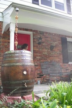 Rain chain into decorative rain barrel with antique finish…blends nicely with house and colors.