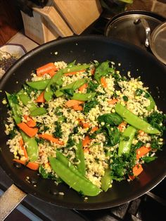 Easy clean meal: carrots, snow peas, corn, kale, spinach, brown rice stir fried with garlic and olive oil. Add pepper to taste. Super yum and super healthy