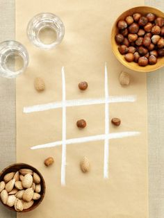 Make a runner for the kids' table out of craft or butcher paper and keep the little ones entertained with tic-tac-toe. Draw grids on the paper and use two kinds of nuts for X's and O's.