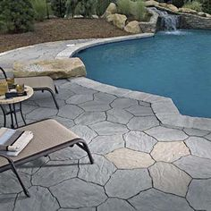 Ideal around pools, these concrete pavers have irregular shapes and textures that mimic the look of real stone and, when wet, are less slippery than the real thing. Shown here: Portage stone in gray, charcoal, and beige.  About $4 per square foot from belgard.com | Photo: Belgard | thisoldhouse.com
